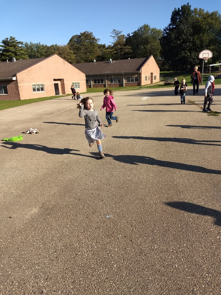 1st grade students playing shadow tag