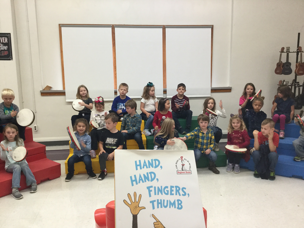 First graders play the drums.