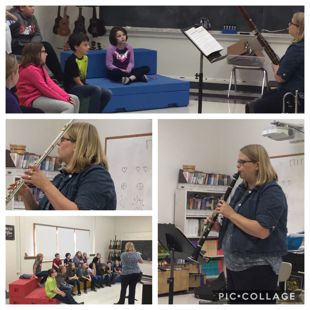 Mrs. Fowell demonstrates woodwind instruments to fourth and fifth graders