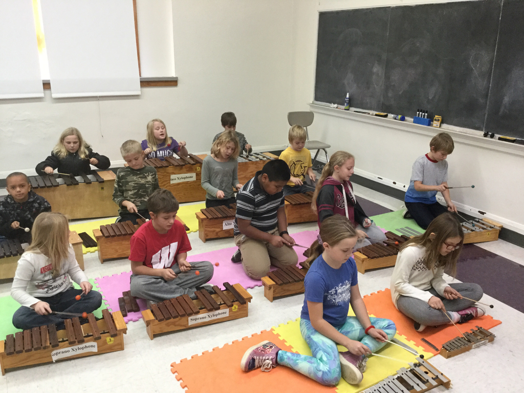 Third graders playing instruments