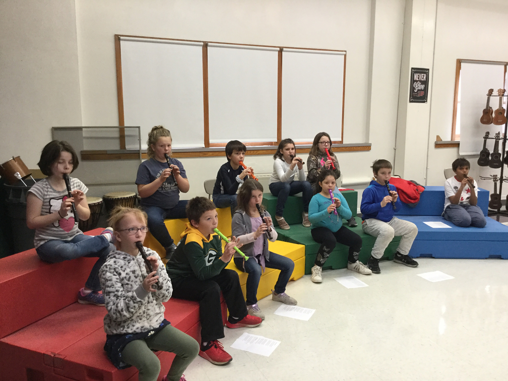 Fourth graders playing recorder.