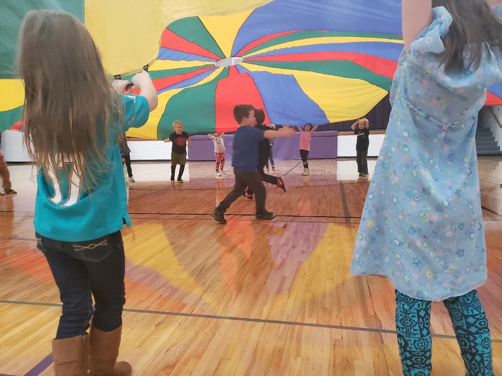 first graders with parachute