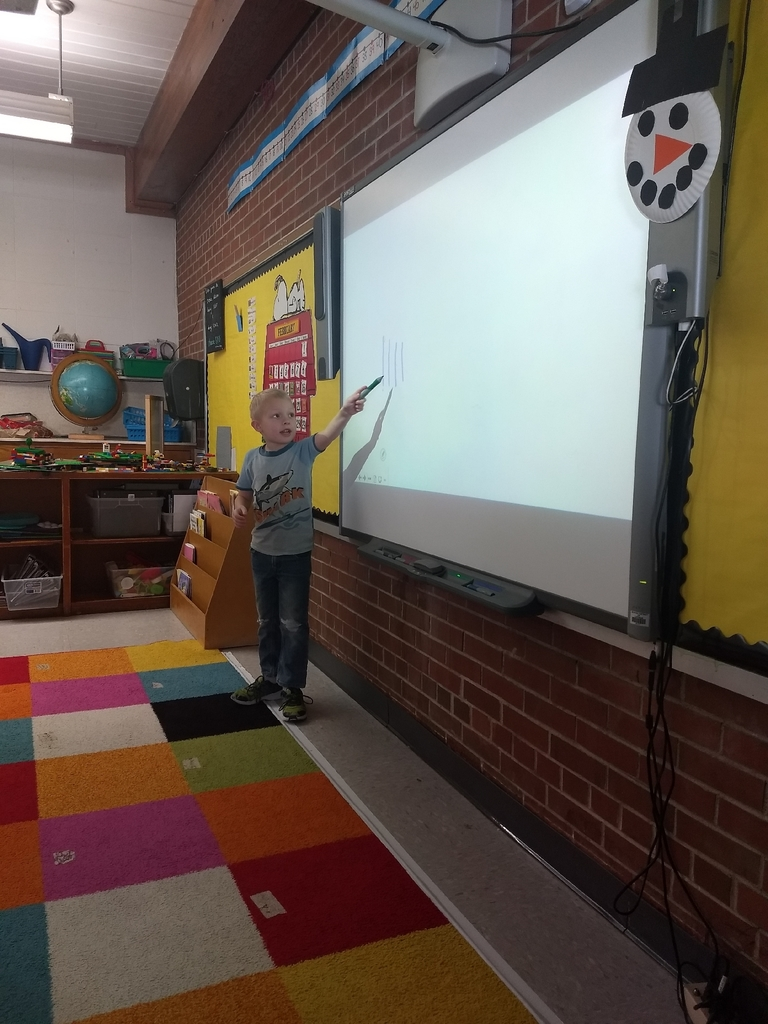 A first grade student teaching his classmates.